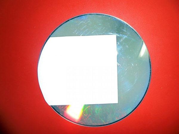 Прямоугольник с одной округлой стороной, наклеенный на диск