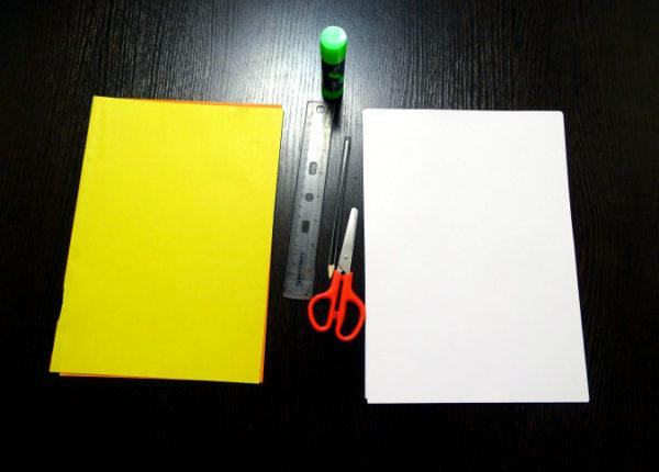 Листы жёлтого картона и белой бумаги, линейка, простой карандаш, ножницы и клей