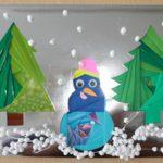 Панно из бумаги, изображающее снеговика и две ёлочки