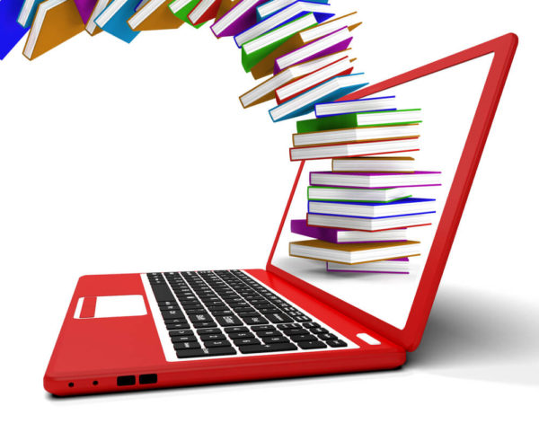 Из монитора красного ноутбука вылетают книги
