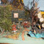 Композиция из природных материалов: лебедь из пластилина, домик на курьих ножках из веточек, лес из еловых веток, домовой (леший) из шишки
