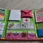 Лэпбук на зелёной основе в виде буклета с кармашками, справа — макет красной книги