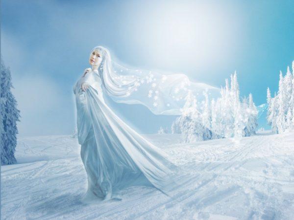 Зима в образе красавицы окутывает землю снежным покрывалом