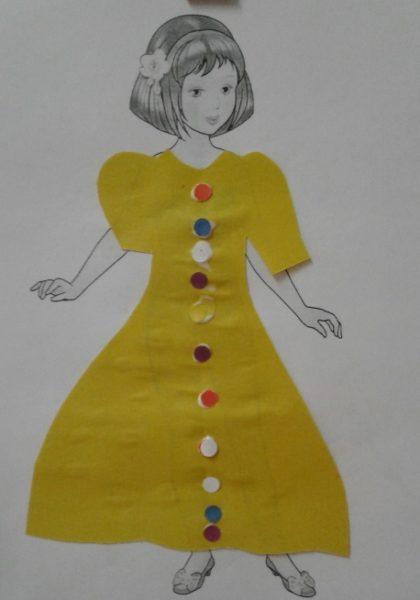 Кукла в жёлтом платье из цветной бумаги