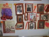 Стенгазета и портреты солдат на стене