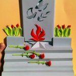 Серый мемориал с Вечным огнём