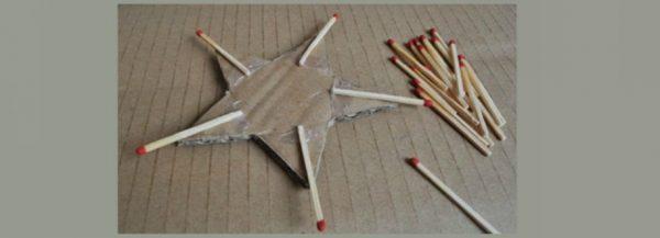 К вершинам картонной звезды приклеено по спичке