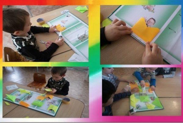 Дошкольники сами вырезают и приклеивают кармашки лэпбука