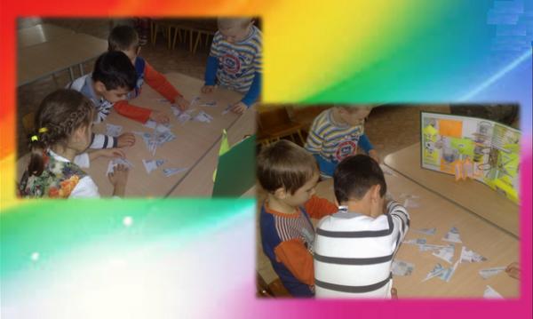 Дошкольники на столе собирают пазлы «Денежные купюры»