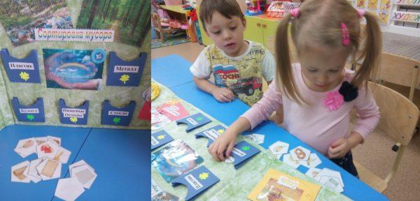 Игра Сортировка мусора; девочка распределяет карточки по группам