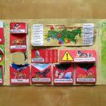 Лэпбук на зелёном фоне с красными конвертами